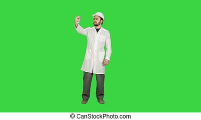 Engineer or architect taking a selfie showing gesture on a Green Screen, Chroma Key.