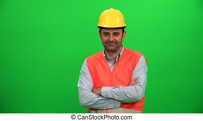 Engineer or Construction Worker Looking on Green Background