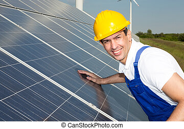 Engineer or installer inspecting solar energy panels