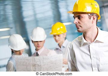 Engineer - Portrait of confident foreman in helmet in...
