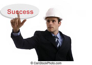 engineer pressing the success key