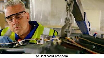 Engineer repairing aircraft engine 4k