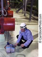 Engineer running tests - Engineer conducting temperature...