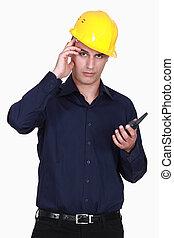 Engineer scratching his head