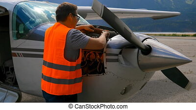 Engineer servicing aircraft engine 4k