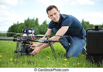 Engineer Setting Camera On Photography Drone - Portrait of...
