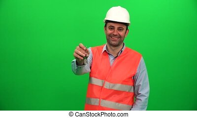 Engineer Showing Keys in front of Green Screen