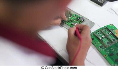 engineer soldering fee close up.