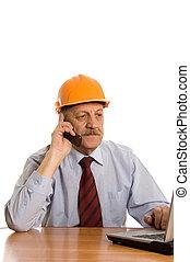 Engineer speaks by phone isolated