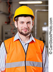 Engineer standing in production area
