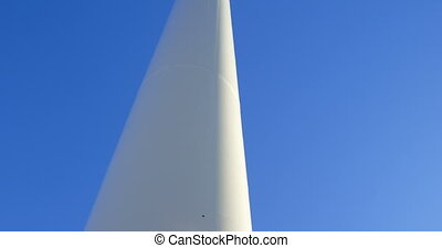 Engineer standing on a wind mill 4k - Male engineer standing...