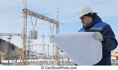 Engineer supervising at electric power station