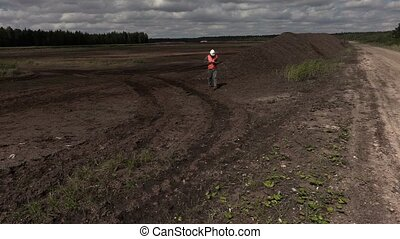 Engineer take pictures  peat bog