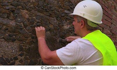 Engineer take samples of old brick wall