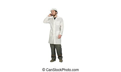 Engineer talking on the phone on a construction site on white background.