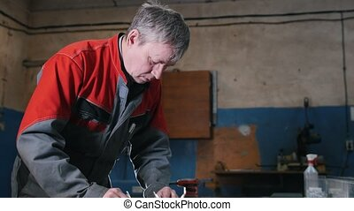 Engineer use trammel technician measuring cutting tool before cnc milling machine center at tool workshop