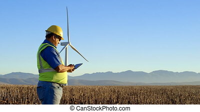 Engineer using digital tablet in the wind farm 4k