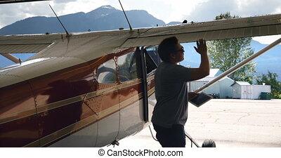 Engineer using digital tablet while examining aircraft 4k
