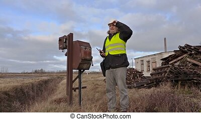 Engineer using tablet and checking territory