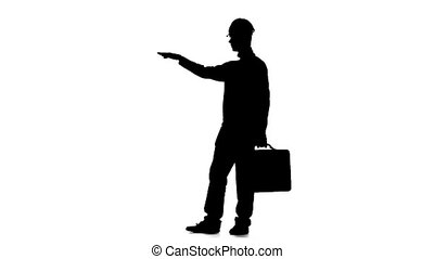 Engineer with a diplomat in his hands and a helmet on his head. Silhouette. White background. Slow motion