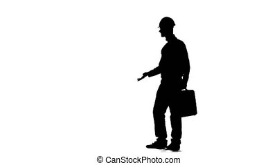Engineer with a diplomat in his hands and a helmet on his head. Silhouette. White background