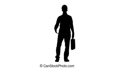 Engineer with a diplomat in his hands . Silhouette. White background. Slow motion