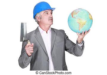 Engineer with a globe