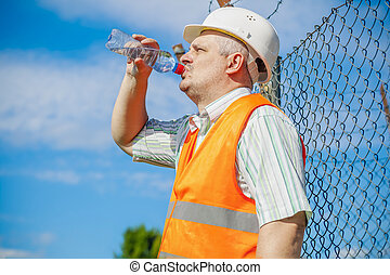 Engineer with bottle of water