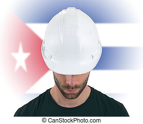 Engineer with flag on background - Cuba