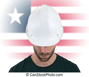 Engineer with flag on background - Liberia