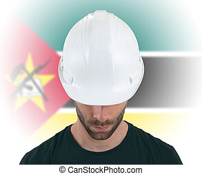 Engineer with flag on background - Mozambique