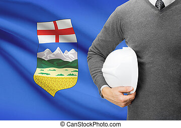 Engineer with flag on background series - Alberta