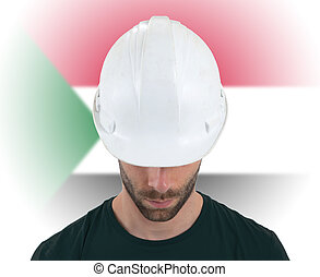 Engineer with flag on background - Sudan