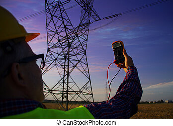 Engineer with gauge during power line infrastructure inspection