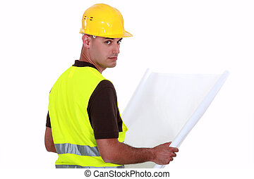 93e19eca5d4 Engineer with plans. Engineer with plans · Asian Indian male contractor engineer  reading blueprint