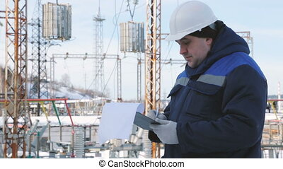 Engineer with tablet at electric power station
