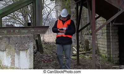 Engineer with tablet PC checking territory