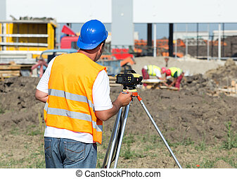 Engineer with theodolite - Surveyor engineer working with ...