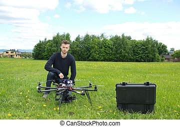 Engineer With UAV Helicopter in Park
