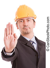 Engineer with yellow hat making stop sign - focus on hand