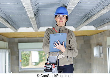engineer woman with clipboard