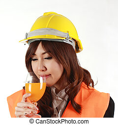 Engineer woman with orange Juice