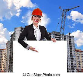 Engineer woman with poster - Engineer woman holding blank...
