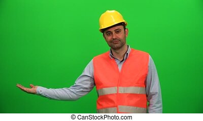 Engineer Worker Lifting Or Presenting Something on Green Screen