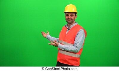 Engineer Worker Making Presentation Gestures on Green Screen. Showing Back Side.