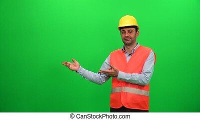 Engineer Worker Making Presentation Gestures on Green Screen. Showing Right Side.