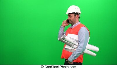 Engineer Worker With Blueprints Talking With Cell Phone, Green Screen Background