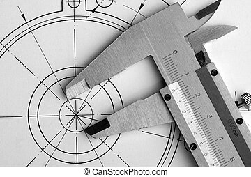 Engineering drawing and caliper - Close-up of engineering...
