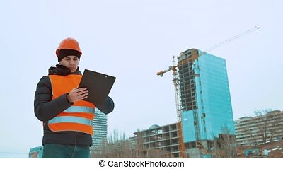 Engineering man Consulting People on construction site...