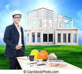 engineering man with working table and home project on beautiful
